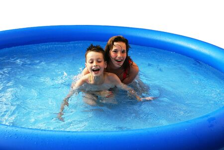 Two kids having fun in a swimming pool. photo
