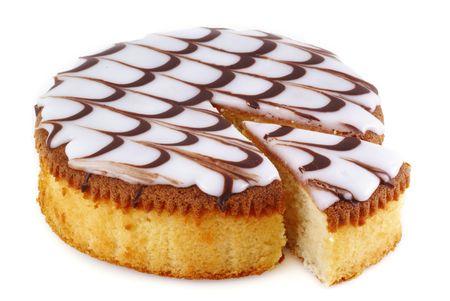 Delicious round cake on a white background.        photo