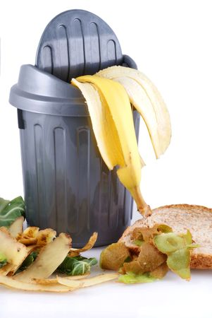 composting: Garbage can with green waste; isolated on a white background. Stock Photo