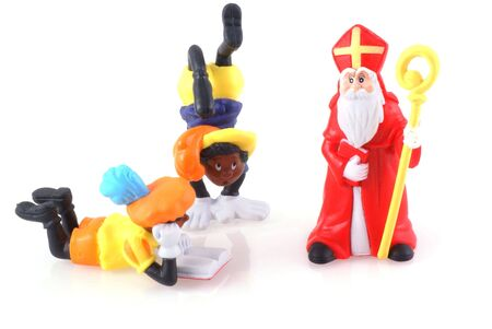 pieten: Sinterklaas and black pieten, characters from a traditional dutch holiday; isolated on white.