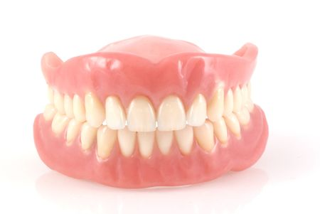 plaque: Dentures isolated on a white background.