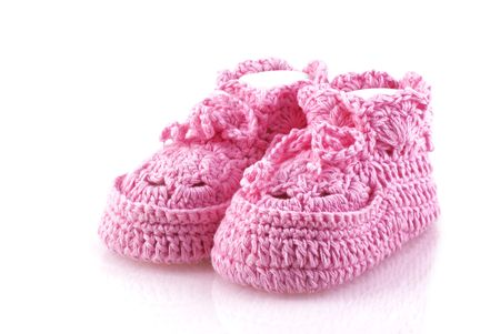 Cute pink footwear on a white background. photo