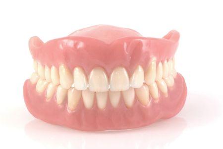 prothese: Zahnersatz isoliert auf einem wei�en Hintergrund.