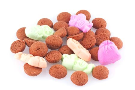 strooigoed: Close up of some candy eaten in Holland during a dutch holiday called sinterklaas; isolated on white. Stock Photo