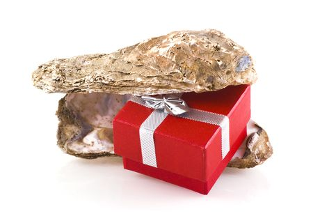 Oyster shells with little red jewelry box in between, isolated on white. photo