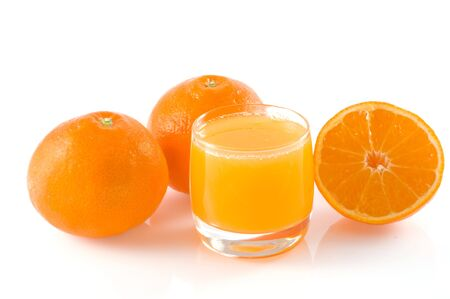 Two and half orange and a glass of fresh orange juice, isolated on white. photo