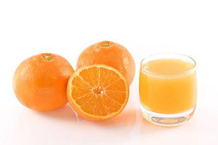 Oranges and a glass of fresh orange juice, isolated on white. photo