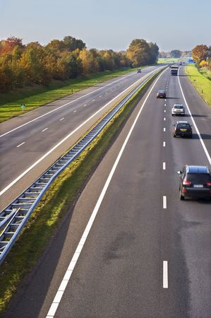 Part of a european highway with cars in motion. photo