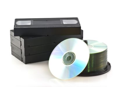 Videotapes and a pile of DVDs on a white background. photo