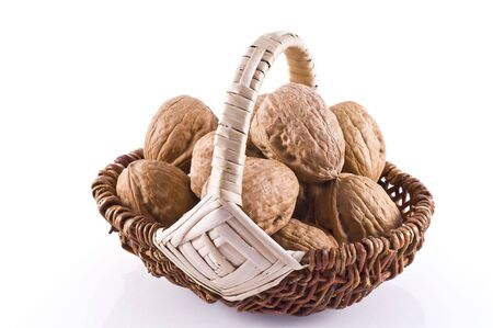 Basket filled with walnuts, isolated on white. Stock Photo - 6200228
