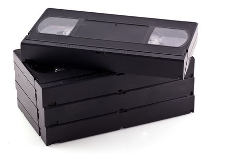 Pile of videotapes, isolated on a white background. photo