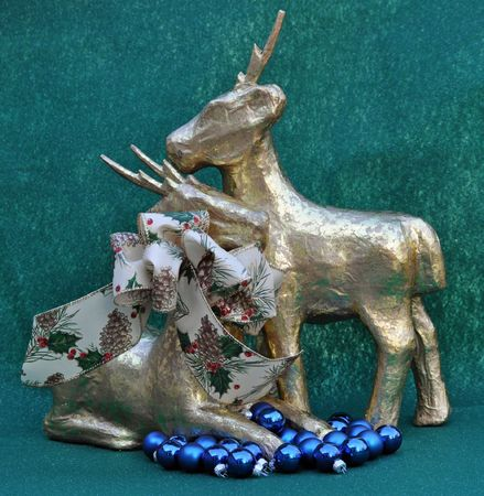 2 deer and blue ornaments and bow
