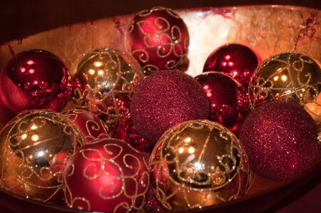 bowl of red and gold ornaments