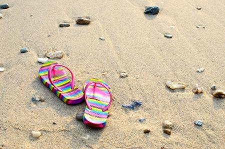 colourful  flip-flops on the seashor