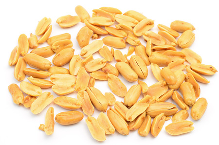Close up of fried, peeled and salted peanuts isolated on white background Stock Photo