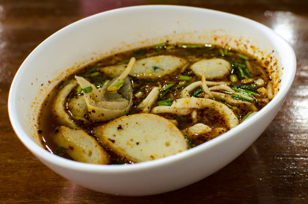 Spicy Fish Noodle With Wonton and Fish Balls  in Tomyum Soup  , Thai Food Stock Photo