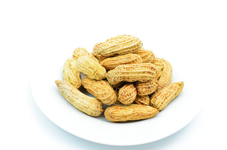 Peanuts isolated on white background close up