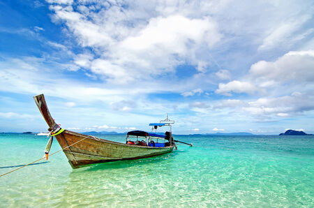 Beautiful Beach and Traditional Longtail Boats  in Phuket, Thailand