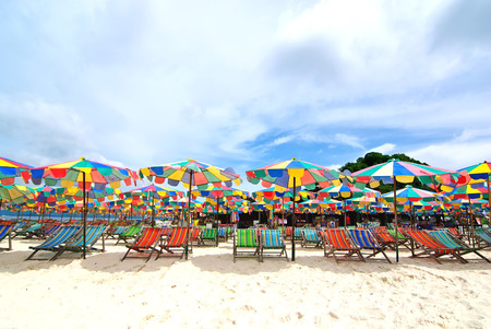 Beach chairs and colorful umbrella on the beach in sunny day, Phuket Thailand Stock Photo