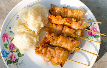 Traditional Thai Style Grilled Pork With Stick Rice