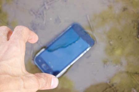 the phone fell from the hands on the water