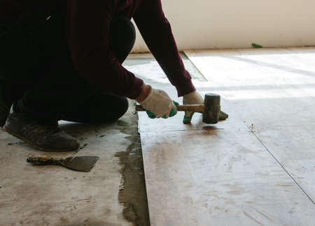 Tile laying tiles at home.