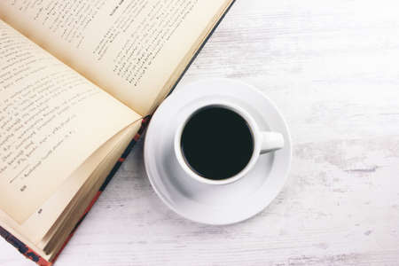 book with black coffee on the table