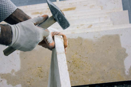 man works with a stone 版權商用圖片