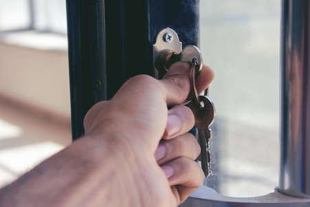man opens a glass door