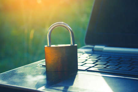 Lock on laptop as computer protection and cyber safety 版權商用圖片