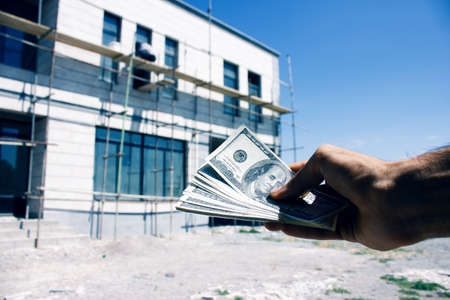 man gives money for building a house
