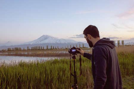 man takes a sunset photo
