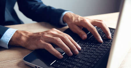 young man works with computer