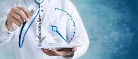 doctor holding a stethoscope and a tablet with dollar icons 版權商用圖片