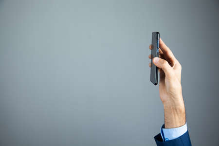business man shows phone in his hand