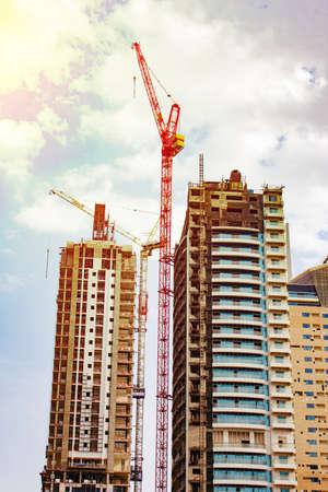large cranes, high-rise building construction