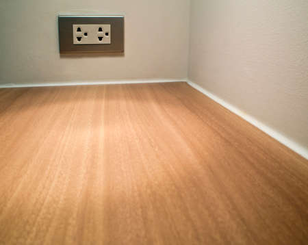 conner: Artificial wood texture on conner of table and Electrial socket Stock Photo