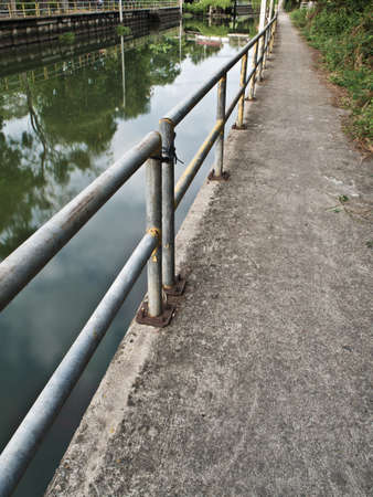poach: Concrete Walk way along the drainage canal