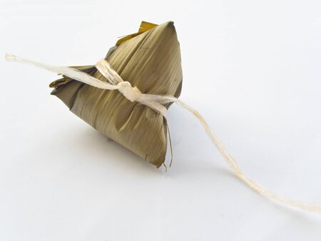 Sticky rice, egg and pork wrapped in bamboo leave
