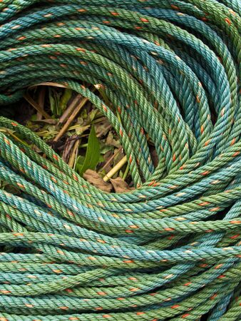 synthetic fiber: Roll bristly of green nylon rope Stock Photo