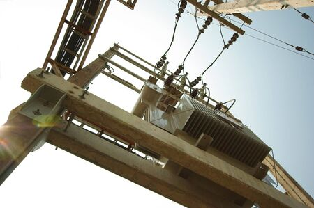wire frame: Electrical transformer on concrete pole Stock Photo