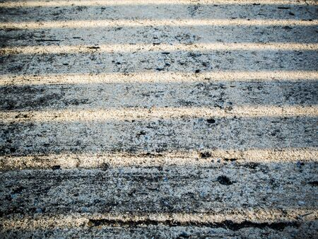 punctuate: line of light on rough concrete floor Stock Photo