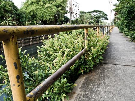 encroach: Concrete Walk way along the drainage canal