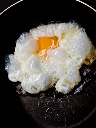 sunny side: Sunny side up frying egg in a pan Stock Photo