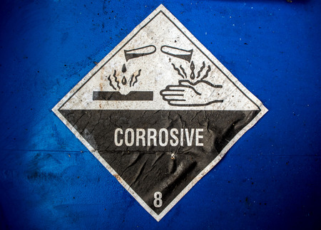 corrosive: Transport index of corrosive material at the acid container Stock Photo