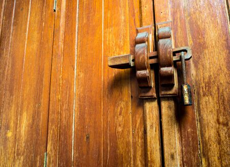 Wooden cabinet door and lock at the handle