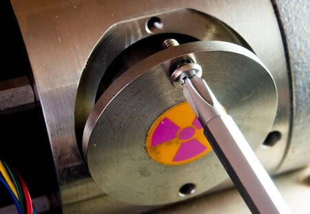 Opening the cover of Radioactive container in the part of machinery Stock Photo
