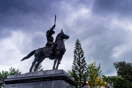 Equestrian Statue of King Located on the high altar of worship. Under overcast skies