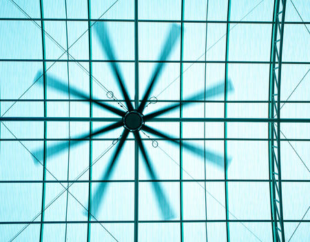 A big electric roof fan and the light under translucent roofing