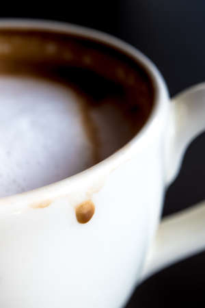decreased: Stain of Hot milk coffee and soft froth at the white ceramic cup